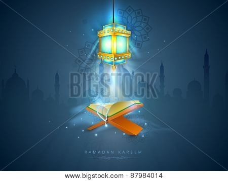 Islamic religious book Quran Shareef with rosary shining in the lantern's light on Mosque silhouette background for Islamic holy month of prayers, Ramadan Kareem celebration.