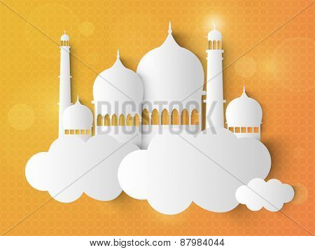 Beautiful mosque in between white clouds on yellow background for Islamic holy month of prayers, Ramadan Kareem celebrations.