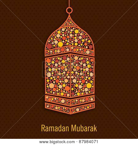 Hanging colourful lantern on brown background for Islamic holy month of prayers, Ramadan Kareem celebration.