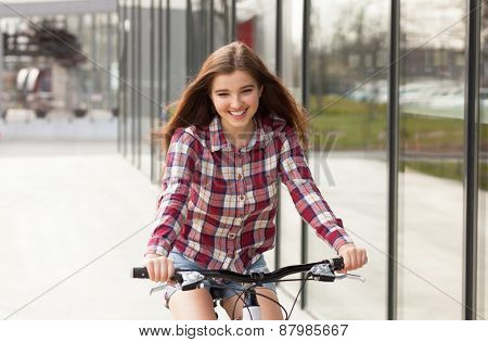 Young beautiful woman on a bicycle ride