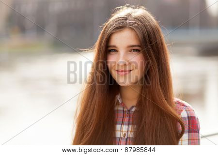 Outdoor natural face portrait of a beautiful young woman