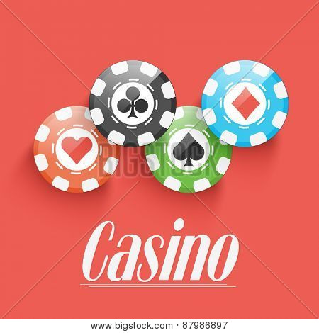 Shiny colorful Casino chips on red background.