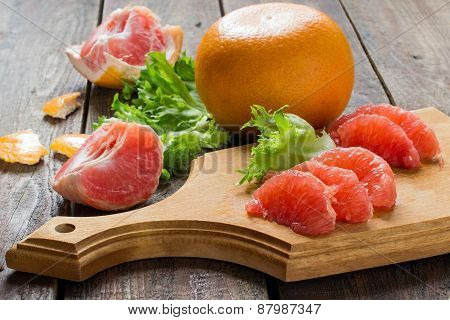 Grapefruit, Lettuce And Slices For A Salad