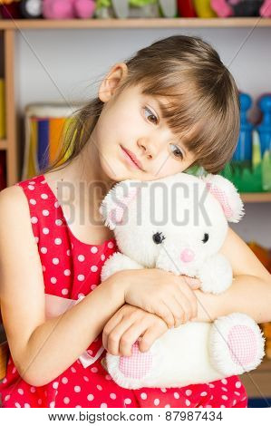 6 Years Old Girl Blond Hair, Red Dress With White Polka Dots, Toy White Bear