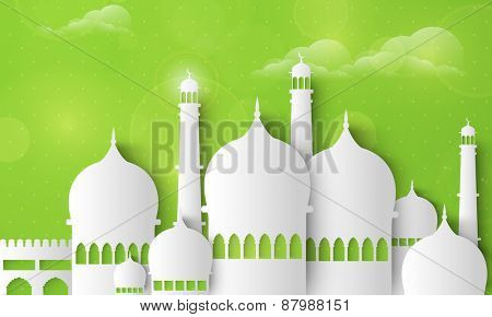Holy month of muslim community, Ramadan Kareem celebration with illustration of islamic mosque made by paper cutout on cloudy green background.