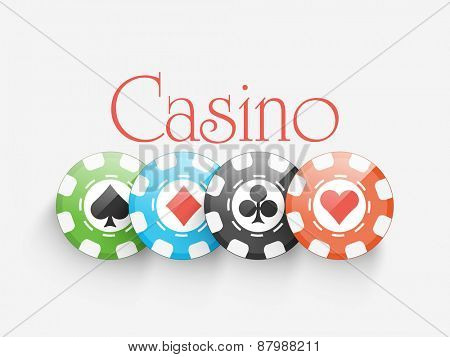 Shiny colorful Casino chips on grey background.