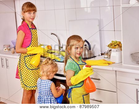 Children little girl cooking at kitchen.