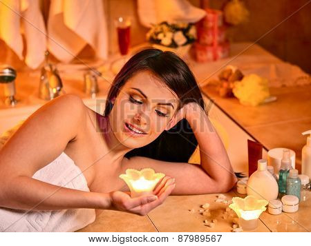 Woman relaxing at home luxury bath. Burning candles