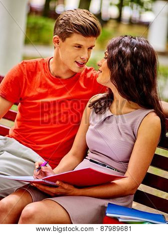 Couple student with notebook summer outdoor.