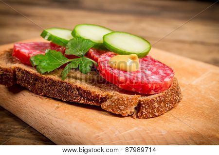 sandwich with sliced sausage