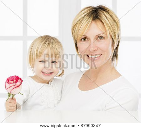 Forty years mother with her two years old baby girl