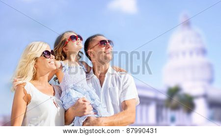 summer holidays, travel, tourism and people concept - happy family over american white house background