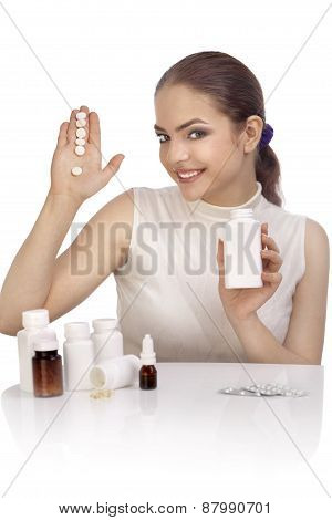 Young Woman Showing Exclamation Mark Made From Pills