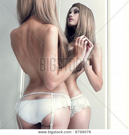 Seductive Girl In The Mirror