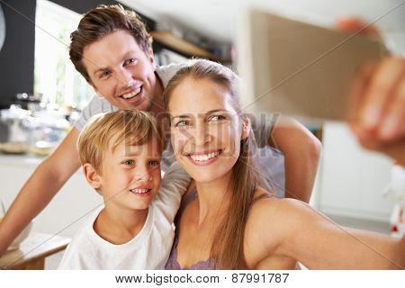 Family Posing For Selfie At Breakfast Table