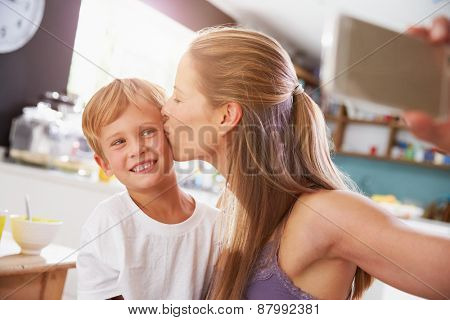 Mother And Son Posing For Selfie At Breakfast Table