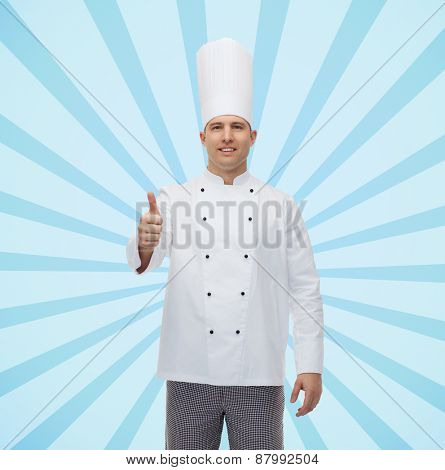 cooking, profession, gesture and people concept - happy male chef cook showing thumbs up over blue burst rays background