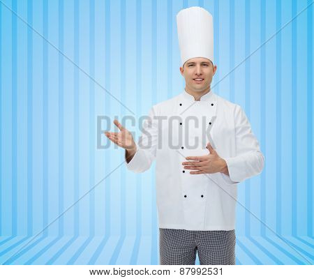 cooking, profession and people concept - happy male chef cook inviting over blue striped background