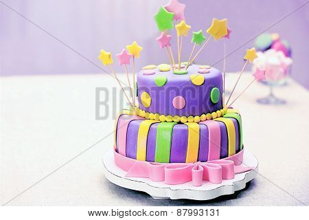 Delicious birthday cake on table