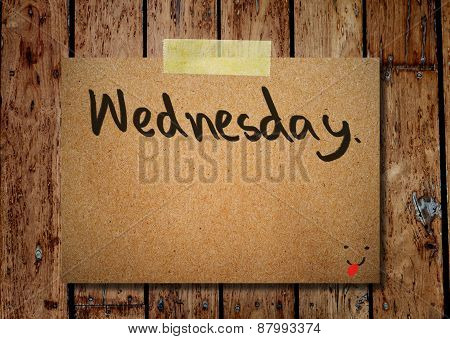 Wednesday On Note Paper With Wooden Background