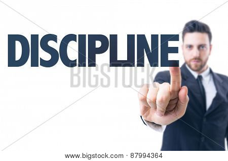 Business man pointing the text: Discipline
