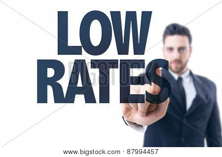Business man pointing the text: Low Rates