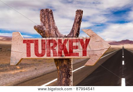 Turkey wooden sign with road background