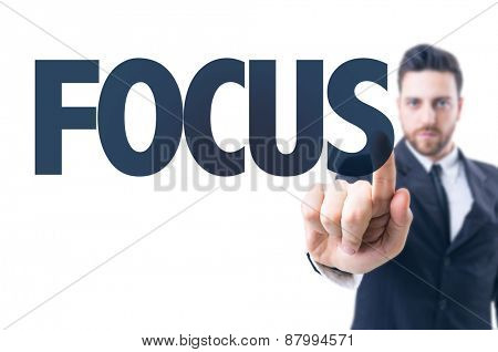 Business man pointing the text: Focus