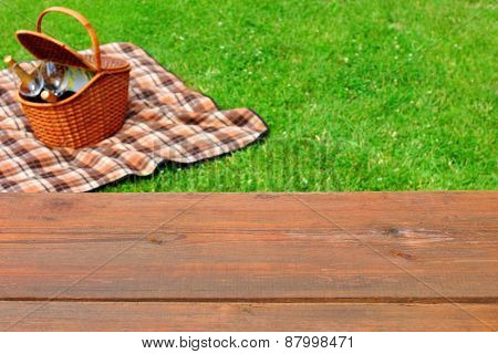 Picnic  Tabletop Close-up. Picnic Basket And Blanket On The Lawn
