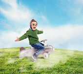 picture of playtime  - Cheerful boy kid playing at the aviator - JPG