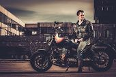 image of ape-man  - Biker and his bobber style motorcycle on a city streets  - JPG