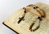 stock photo of glorify  - The book of Catholic Church liturgy and rosary beads - JPG