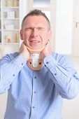picture of neck brace  - Man with a surgical cervical collar suffering from neck pain - JPG