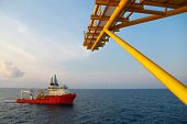 stock photo of offshore  - Supply boat operation shipping any cargo or basket to offshore - JPG