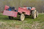 stock photo of tractor trailer  - Old dirty tractor with trailer on a field - JPG