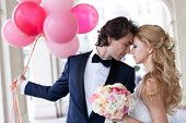 picture of married  - Young just married couple posing in a romantic way - JPG