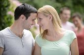 stock photo of heterosexual couple  - Portrait of a happy young heterosexual couple looking at camera - JPG