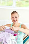 Positive Young Woman Doing The Laundry