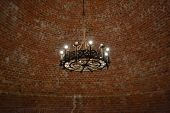 picture of chandelier  - Interior of an old castle with a vintage chandelier in Sigulda Latvia - JPG