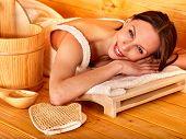stock photo of sauna woman  - Young woman relaxing in sauna - JPG