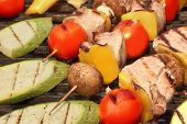pic of kebab  - Delicious Mixed Kebabs BBQ On Hot Grill Background - JPG