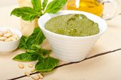 picture of pesto sauce  - Italian traditional basil pesto sauce ingredients on a rustic table - JPG
