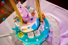stock photo of christening  - Christening cake with pink teddy bear in natural light - JPG