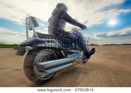 Biker man riding on a motorcycle. Bottom view
