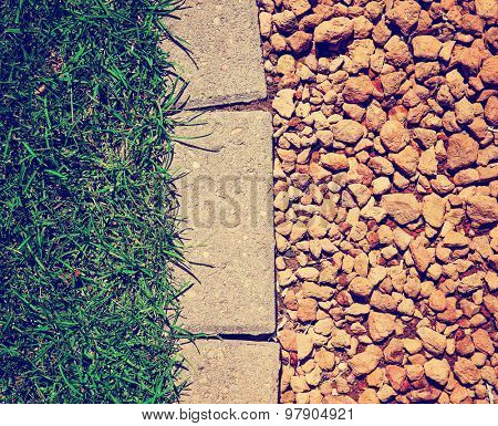 grass bricks and stone landscaping in a nice manicured yard good for textures or a  background