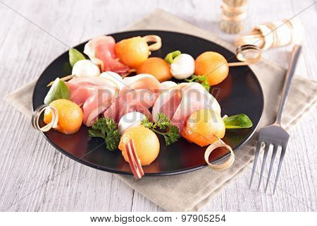 appetizer, melon,mozza and prosciutto
