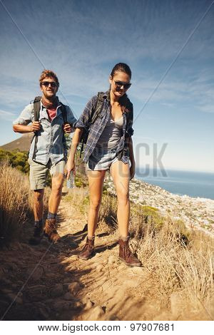 Avid Hikers In Countryside
