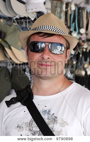 Man Poses In Hat Store