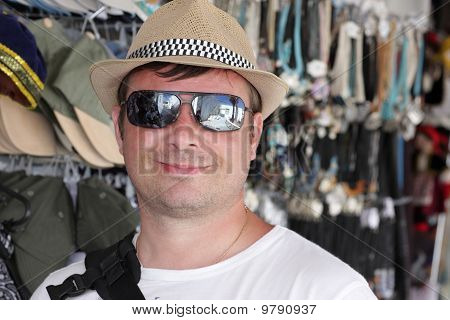 Happy Man Poses In Hat Store