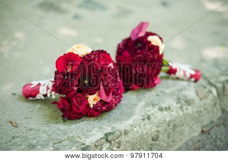 wedding bouquets on stone background